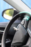 Rear-view mirror and steering wheel of the car Royalty Free Stock Photography
