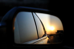 Rear-view mirror in the sun Stock Photography