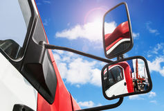 Rear-view mirror on the truck Stock Photos