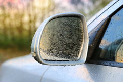 Rear-view mirror in water drops Stock Photography