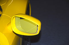 Rear view mirror Yellow sports car Stock Photo
