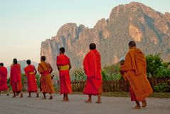 Rear view of monks were alms out at VangVieng, Laos royalty free stock image
