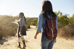 Rear View Of Mother And Adult Daughter Hiking In Countryside Royalty Free Stock Photo