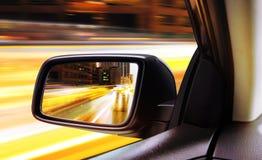 Rear-view of moving car at night Stock Photos