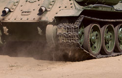 Rear view of moving old russian tank Stock Photo