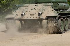 Rear view of moving old russian tank Stock Photography