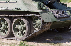 Rear view of moving old russian tank Royalty Free Stock Images