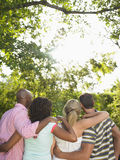 Rear view Of Multiethnic Friends With Arms Around Stock Photography