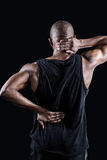 Rear view of muscular man suffering from backache Royalty Free Stock Photos