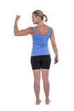 Rear view of muscular woman flexing muscles. On white background Royalty Free Stock Photos