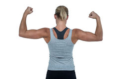 Rear view of muscular woman flexing muscles. On white background Stock Photo