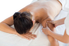 Rear view of naked woman receiving massage Stock Photo
