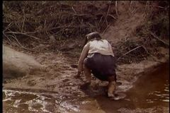 Rear view of a Native American girl running uphill stock video footage