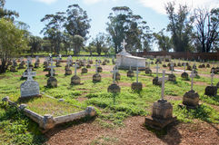 Rear View of New Norcia Cemetery. NEW NORCIA,WA,AUSTRALIA-JULY 15,2016: Rear view of New Norcia Cemetery with rows of cross topped gravestones in ordered rows Stock Images