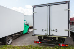 Rear view of new standing white trucks Royalty Free Stock Image