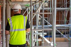 Free Rear View Of A Builder, Architect Or Construction Worker On Building Site Royalty Free Stock Images - 159834919