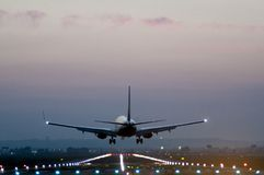 Free Rear View Of A Plane Taking Off From A Runway At An Airport Stock Image - 115545651