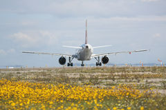 Rear View Of An Airplane Landing Stock Photo