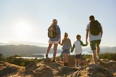 Free Rear View Of Family Standing At Top Of Hill On Hike Through Countryside In Lake District UK Royalty Free Stock Photography - 134204307