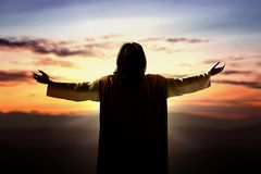 Free Rear View Of Jesus Christ Raised Hands And Praying To God Stock Photo - 159824370