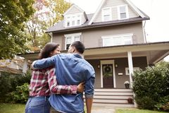 Free Rear View Of Loving Couple Walking Towards House Stock Image - 108967091