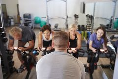 Free Rear View Of Male Trainer Taking Spin Class In Gym Royalty Free Stock Images - 134202519