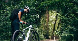 Free Rear View Of Professional Male Cyclist Cycling On Mountain Road On Nature Background. Male Bicyclist Riding A Bike In The Forest Stock Images - 196215764