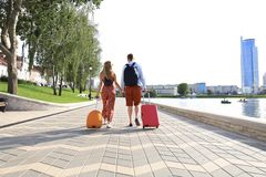 Free Rear View Of Tourist Couple Holding Hands And Dragging Luggage, Sightseeing Visiting Street, Outdoors Royalty Free Stock Image - 161052016