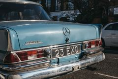 Rear view of old blue Mercedes-Benz 600 parked in London, UK, on a sunny day. London, UK - February 23, 2019: Rear view of old blue Mercedes-Benz 600 parked on a stock image