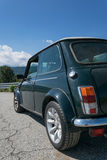 Rear view of an old Mini Cooper. Rear view of a classic British Green Mini Cooper on a sunny day royalty free stock image