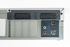 Rear view of an old VHS recorder from 1990s. Old VHS video recorder plugs isolated on white background Royalty Free Stock Photos