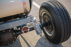 Rear view of old vintage customized hot rod car wheel and other parts. Nice closeup view of rear old vintage customized hot rod car wheel and other parts Royalty Free Stock Image