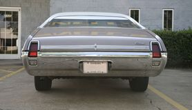 Rear View of  Oldsmobile Cutlass Supreme. Rear quarter of a Oldsmobile Cutlass Supreme is a mid-size car produced by Oldsmobile between 1966 and 1997. It was Royalty Free Stock Photography