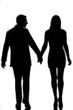 Rear view one couple walking hand in hand Royalty Free Stock Photos