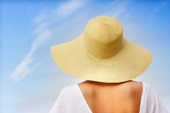 Rear View Otf Young Woman In Hat On Sky Background Royalty Free Stock Photography