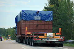 Rear View of Oversize Load Transport on the Road Stock Photo