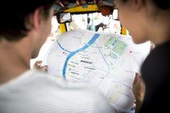 Rear view of people checking using Bangkok Thailand map stock photo