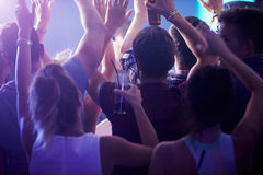 Rear View Of People Dancing In Nightclub Royalty Free Stock Photography