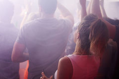 Rear View Of People Dancing In Nightclub Royalty Free Stock Image