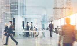 Rear view of people in glass meeting room, toned stock photos