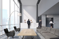 Rear view of people in an office waiting area Royalty Free Stock Photos