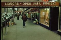 Rear view of people walking down New York City street stock video footage