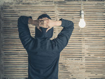 Rear view of person by light bulb Royalty Free Stock Image
