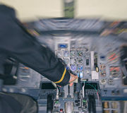 Rear view of pilot in aircraft cabin. Royalty Free Stock Photos
