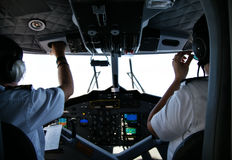 Rear view of pilot and copilot in cockpit Royalty Free Stock Image