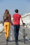 Rear view portrait of a young couple walking outdoors Royalty Free Stock Images