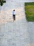 Rear view portrait of a young man cycling Foto de Stock
