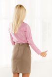 Rear View Of Pretty Blonde With Thumb-Up Royalty Free Stock Image