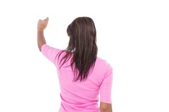 Rear view of pretty brunette pointing something Stock Photos