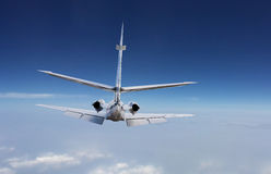 Rear view of a private jet. Flying at a high altitude Stock Photos